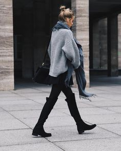Black leggings, big sweater, perfect tall black boots...great style