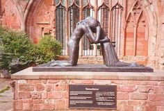COVENTRY - THE STATUE OF RECONCILIATION BY  JOSEFINA DE VASCONCELLOS IN THE CATHEDRAL RUINS