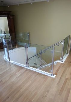 Another from our friends at Denver Glass Interiors. Here you can see our square glass clamps and stainless posts and railings.