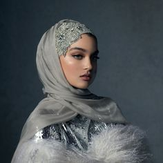 Discover unsurpassed glamour with the Celestial Silver hijab. Custom-designed crystal embellishments adorn the caplette for a royal look, paired with two opulent silver hijabs for infinite styling options. Hijabi Wedding, Muslimah Wedding Dress, Muslim Brides, Disney Wedding Dresses, Pakistani Wedding Dresses, Muslim Prom Dress, Bridal Hijab Styles, Hijab Stile, Modele Hijab