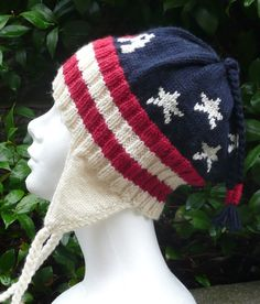Free Knitting Pattern for Patriotic Earflap Hat - Inspired by the hat worn by US skier Julia Mancusoafter she won silver in the Olympics, this hat features stars and stripes with the letters USA on the front. I think you could easily adapt this to leave off the earflaps for a year-round hat, or fold the earflaps up into the hat. Designed by Marleen ofbelgianwaffleknit