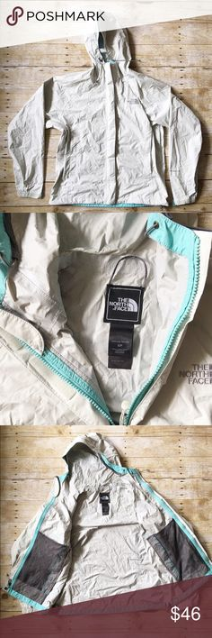 Off white/turquoise HYVENT DT North Face jacket S Beautiful off white HYVENT DT North Face jacket. Perfect raincoat! Size small petite. Amazing quality jacket in very good condition. Has slight wear on the inside lining along the hood crease and a few black markings on one side. Not all that noticeable unless looking for it! *has a bit of a green tint to the off white color in my opinion. If you have any questions, please don't hesitate to ask! North Face Jackets & Coats Utility Jackets