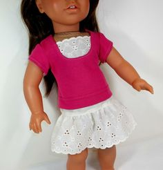 bright pink t shirt and ivory eyelet skirt.    Eyelet skirt is paired with a bright pink t shirt with an eyelet insert at the front.    Skirt has elastic waist, shirt has velcro closures at the back. All seams are serged.    This adorable outfit is made using adapted LibertyJane patterns!