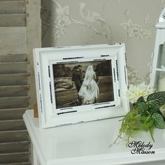 White Photograph Frame A simple but elegant photograph frame in an white aged distressed finish This would be perfect for holding a photo of a loved one, ideal size for a bedside table  Photographs can be placed horizontal or vertical, holds photo 10cm x 15cm  Made from wood in a freestanding design