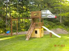 Playhouse with a second floor slide and swings, with a thrird floor airplane cockpit complete with gauges and switches.