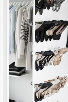 A custom walk-in closet featuring a stylish home for an extensive shoe collection #closet #shoes #organization