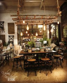 Love this ladder light fixture above the table.
