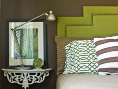 """In a small guest bedroom, a wall-mounted bedside table can offer just enough space to hold a lamp and a clock without dominating the tight square footage. For a bedroom that's shared by two, """"pick an adjustable lamp with variable levels of light,"""" says Michelle Hinckley, """"so one person can read without disturbing the other."""""""