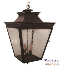 Strong on detail, this Genie House hanging lantern is enhanced by brass filigree that runs along the hammered dish top. Available in brass or copper and a variety of finish options.