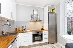 FINN – Gamlebyen: Meget delikat, lys og gj. gående 2-roms med høy standard og peisovn - Moderne kjøkken og bad