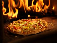 #Upscale #casual, #Italian #American #restaurant featuring BOTH wood fired oven pizzas & traditional slate deck, gas oven, #pizzas. #woodfiredpizza