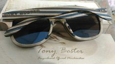 Made by :tony boster fingerboard wheels.wooden glasses.
