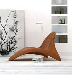 -love to read while sitting in this chair! .. maybe not next to that painting though..