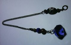 Blue ter pendulum with enamel bead fob