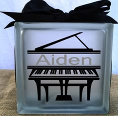 A personal favorite from my Etsy shop https://www.etsy.com/listing/228807589/piano-music-glass-block-light-night