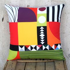 This unique series will definitely be loved by anyone who is charmed by special graphic designs and intense colors. Pillows that have a standpoint and can stand independently giving your space vividness along with a clear artistic view. They can match easily with the Three Vertical Black or White Mirrors series or with intense one color pillows.