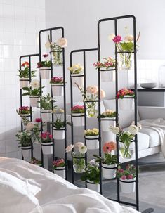 Room Divider Ideas - 10 Examples Of Multi-Functional Room Dividers // A divider filled with flowers and plants is a great way to create separation between spaces and brightens up the whole area.