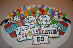 - 50th birthday cookie display with 50 candle cookies and fire extinguishers