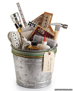 Housewarming Bucket Gift Basket filled with practical goodies.