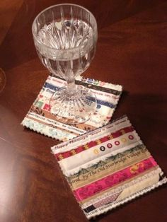 nice coasters. They're like little quilts, with batting and backing. She just trimmed them with pinking shears, so you can feel the soft batting around the edges. this is SO my next project. great way to get all the quilting ideas out of my head on a small scale.