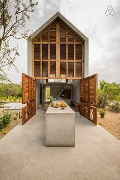 CASA TINY NEAR CASA WABI - Tiny house in Puerto Escondido with outdoor living and dining space, and shutters for windows and doors offering cool breezes to flow through Tiny House Movement, Modern Tiny House, Tiny House Design, Tiny Beach House, Casa Wabi, Concrete Houses, Concrete Table, Concrete Board, Concrete Design
