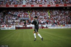 #Ronaldo runs over to the Madrid supporters as his goals kept the team two points behind Barcelona