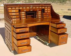There are eight lower drawers, original handles, and one center drawer. There is a pull out work shelf on each side.