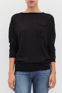 """- 100% Cashmere - Boatneck with rolled-edge - Patch breast pocket - Rib knit cuffs and hem - Side slits - Pull-over style - Color: Black - Model is 5'9"""" and wears a size FR 34."""
