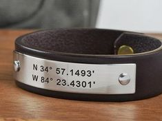"This personalized leather bracelet, hand crafted from top grade leather and durable stainless steel, can be engraved with any text or coordinates of your choice. Personalize with one or two lines of text up to 20 characters (letters, numbers, punctuation) per line.GPS Coordinates Bracelets are a unique way to represent a special location; the spot you said, ""I do"", the birthplace of a child, or even a favorite vacation destination. Personalized Leather Bracelet Details Made from USA Tanned…"