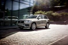 """The all-new Volvo XC90 in Luminous Sand Metallic with a T5 engine and AWD features 19"""" wheels with 10-spoke rims in Turbine Silver Bright, a panoramic glass roof and LED headlights."""
