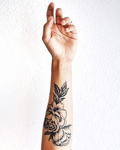 Pretty peony tattoo forearm