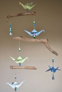 origami mobile with driftwood