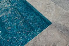 Silver Travertine Pool coping with blue glass mosaics