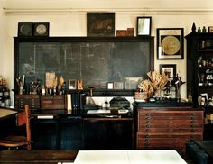 Old-timey classroom complete with wood framed chalkboards and vintage flat file cabinet.