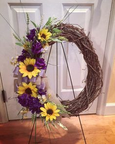 Spring 2016 Grapevine wreath with yellow and purple flowers. Oval shape $45   https://www.facebook.com/WreathsbyKasy/