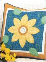 This Giant Daisy Pillow will bring sunshine anytime!  Find the pattern at free-quilting.com.