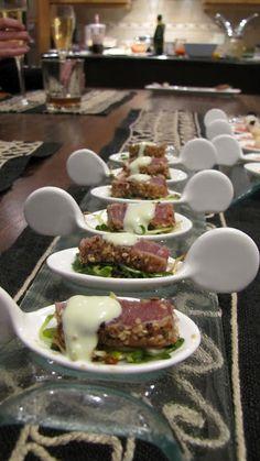 Seared and Crusted Ahi Tuna over   Micro Greens with a Wasabi Aioli Drizzle