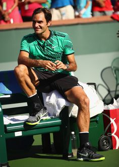 Roger Federer of Switzerland laughs as Stanislas Wawrinka of Switzerland makes his speach after the mens final during day fourteen of the BNP Paribas Open at Indian Wells Tennis Garden on March 19, 2017 in Indian Wells, California.