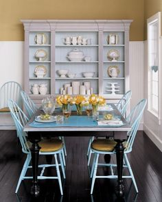 I like the combination of blue and yellow, it makes this kitchen feel warm but not overly staged