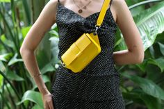 "It's adjustable belt allows you to carry it by the waist or crossbody. It is a casual and elegant piece that will add style to any outfit for your everyday outings. Flap closure with invisible magnetic button. 1 inside pocket.  Size: H4 1/2"" x W6 1/2"" x D1 1/3""  Full grain calf leather  Lining 100% gray cotton. Comes with a dust bag.  Made in Italy. Leather Belt Bag, Calf Leather, D1, Italian Leather, Women's Bags, Fashion Backpack, Calves, Dust Bag, Closure"
