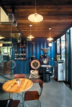 The huge coffee roaster, which is in daily use, was bought on auction by Neil. Café Container, Container Coffee Shop, Container Buildings, Container Architecture, Sustainable Architecture, Shipping Container Cafe, Shipping Containers, Container Restaurant, Café Bar