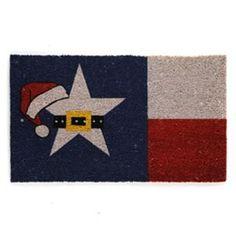 Texas Christmas Coir Doormat. Very cute, but I will not wipe my feet on a Texas flag. Ever.