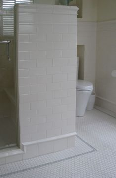 ivory subway tile about 5 feet up the walls, and unglazed porcelain hexagonal tile on the floor