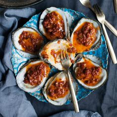 No shucking necessary: The grill does the work here. Once the oysters open, all you do is top them with some of chef David Kinch's smoky, tangy butter.
