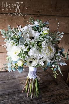 Thank you for visiting Erika with a K Designs! Find the perfect finishing touch for your dream wedding! This listing is for a gorgeous artificial flower bouquet filled with white roses, anemones babys breath, ranunculus, and greenery with pussy willow accents. The bouquet shown is