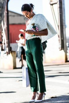 Street Style | One Shoulder Printed Blouse, Green Trouser, White Heels & Vintage Pineapple Clutch