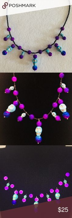 Turquoise skull and purple glass bead necklace. Large and small turquoise skulls with magical purple glass beads on black bead necklace. This is a one of a kind original! Jewelry Necklaces