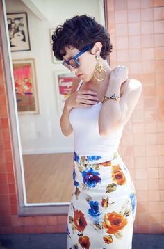 Fashion Blogger It Girl Karla Deras splashes it out in 'Watercolor florals'. Karla was wearing a Madewell tank top, Dolce and Ga...
