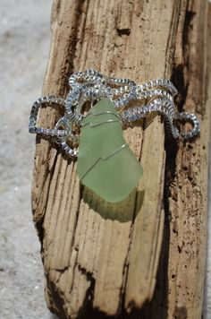 Genuine Aqua Sea Glass Necklace on a sterling silver box chain. The sea glass is authentic frosted beach glass. The necklace is hand wire wrapped