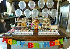 Birthday Donut Party - great for toddler boys or girls. Lots of DIY decorations like confetti balloons, sock donut favors, sprinkle covered cups and more. See post for details.